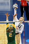 SIOUX FALLS, SD - DECEMBER 9:  Ally Rohn #22 from Palm Beach Atlantic tries to get a kill past Morgan Hooe #2 from Alaska Anchorage during their semifinal match of the Women's Division II Women's Volleyball Championship at the Sanford Pentagon in Sioux Falls, SD. (Photo by Dave Eggen/Inertia)