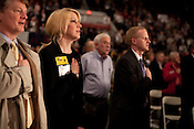 February 16, 2012. Raleigh, NC..  Debra Goldman, a candidate for state auditor, listens to the national anthem..  The North Carolina Republicans held their 2012 Precinct Meeting at Dorton Arena with former Charlotte mayor Pat McCrory as the key note speaker.