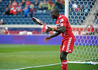 Chicago forward Dominic Oduro (8) plays hot potato with his boot after beating New England goalkeeper Matt Reis (not pictured) and scoring Chicago's second goal.  The Chicago Fire defeated the New England Revolution 3-2 at Toyota Park in Bridgeview, IL on Sept. 25, 2011.