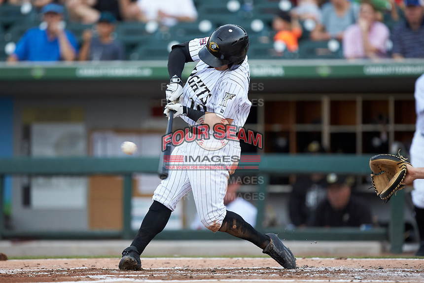 Eddy Alvarez (10) of the Charlotte Knights makes contact with the baseball during the game against the Indianapolis Indians at BB&T BallPark on May 26, 2018 in Charlotte, North Carolina. The Indians defeated the Knights 6-2.  (Brian Westerholt/Four Seam Images)