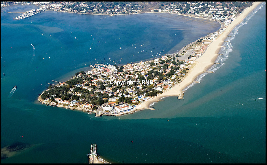 BNPS.co.uk (01202 558833)<br /> Pic: BNPS<br /> <br /> An aerial view of Sandbanks.<br /> <br /> This empty plot of land has gone on the market for a staggering £3.5 million because it is situated NEAR the exclusive address of Sandbanks.<br /> <br /> The narrow parcel of land has nothing on it apart from some overgrown grass, the footings of an old house and a shabby-looking driveway.<br /> <br /> But looking at the property from another point of view reveals why it can command such a hefty asking price as it boasts some of the finest seaside views in the country.