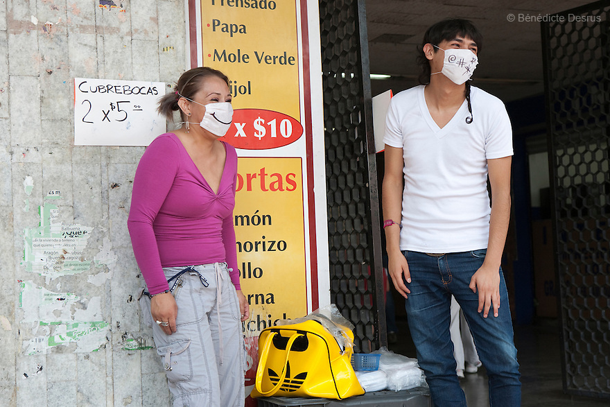 April 25, 2009 - Mexico City, Mexico - Two young mexicans sell surgical masks, in front of a metro station, to protect from the swine Flu. Photo credit: Benedicte Desrus / Sipa Press
