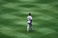 OAKLAND, CA - Ken Griffey Jr. of the Seattle Mariners in action during a game against the Oakland Athletics at the Oakland Coliseum in Oakland, California in 1997. Photo by Brad Mangin