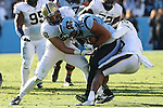 15 November 2014: UNC's Jack Tabb (80) is tackled by Pitt's Reggie Mitchell (15) and Anthony Gonzalez (28). The University of North Carolina Tar Heels hosted the University of Pittsburgh Panthers at Kenan Memorial Stadium in Chapel Hill, North Carolina in a 2014 NCAA Division I College Football game. UNC won the game 40-35.
