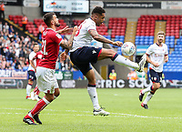 Bolton Wanderers' Josh Magennis competing with Bristol City's Marlon Pack<br /> <br /> Photographer Andrew Kearns/CameraSport<br /> <br /> The EFL Sky Bet Championship - Bolton Wanderers v Bristol City - Saturday August 11th 2018 - University of Bolton Stadium - Bolton<br /> <br /> World Copyright &copy; 2018 CameraSport. All rights reserved. 43 Linden Ave. Countesthorpe. Leicester. England. LE8 5PG - Tel: +44 (0) 116 277 4147 - admin@camerasport.com - www.camerasport.com