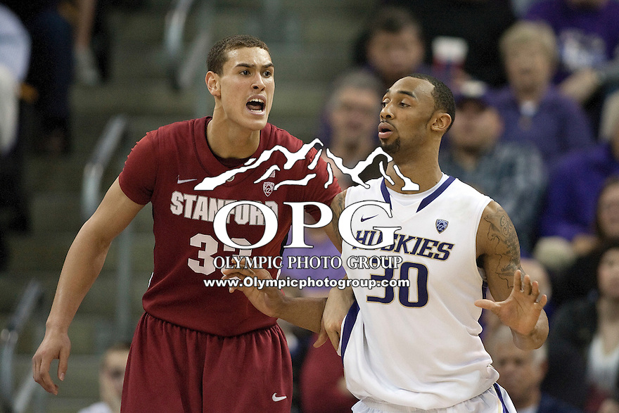 Jan 21, 2012:  Washington's #30 Desmond Simmons battles Stanford's #33 Dwight Powell under the basket.  Washington defeated Stanford 76-63 at Alaska Airlines Arena Seattle, Washington...