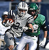 Jake Lazzaro #2 of Oceanside picks up yards after a catch during the Nassau County football Conference I semifinals against Farmingdale at Shuart Stadium in Hempstead on Saturday, Nov. 10, 2018.