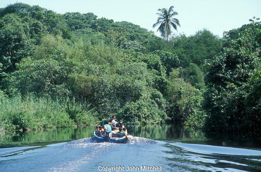 Launch heading up the Estuario San Cristobal to La Tovera freshwater spring outside the town of San Blas, Nayarit. Mexico