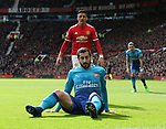 Henrikh Mikhitaryan of Arsenal sits on the ground with Alexis Sanchez of Manchester United behind during the premier league match at the Old Trafford Stadium, Manchester. Picture date 29th April 2018. Picture credit should read: Simon Bellis/Sportimage
