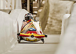 8 January 2016: Nick Cunningham, piloting his 2-man bobsled for the United States of America, enters the Chicane straightaway on his first run, ending the day with a combined 2-run time of 1:51.43 and earning a 6th place finish at the BMW IBSF World Cup Championships at the Olympic Sports Track in Lake Placid, New York, USA. Mandatory Credit: Ed Wolfstein Photo *** RAW (NEF) Image File Available ***