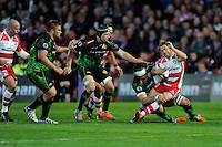 Greig Laidlaw of Gloucester Rugby is tackled by Kai Horstmann of Exeter Chiefs during the European Rugby Challenge Cup semi final match between Gloucester Rugby and Exeter Chiefs at Kingsholm Stadium on Saturday 18th April 2015 (Photo by Rob Munro)