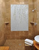 Custom Willow natural stone hand cut shower medallion.