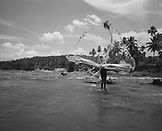 SRI LANKA, Asia, fisherman throwing fishing net in Maha Oya river (B&W)