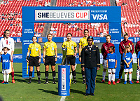 FRISCO, TX - MARCH 11: The military escort stands withe SheBelieves Cup trophy during a game between England and Spain at Toyota Stadium on March 11, 2020 in Frisco, Texas.