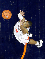 Virginia forward Akil Mitchell (25) reaches for the rebound during the game against Wake Forest Wednesday Jan. 08, 2014 in Charlottesville, Va. Virginia defeated Wake Forest 74-51.