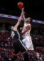 Ohio State Buckeyes forward Sam Thompson (12) is guarded by Bryant University Bulldogs forward Dan Garvin (22) during Wednesday's NCAA Division I basketball game at Value City Arena in Columbus on December 11, 2013. Ohio State won the game 86-48. (Barbara J. Perenic/The Columbus Dispatch)