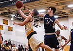 WATERBURY, CT. 09 January 2020-010920BS206 - Kaynor Tech's Scott Dalesio (2), left, goes up and under against Wolcott Tech's Blake Sanford (22), during a Boy Basketball game between Wolcott Tech and Kaynor Tech at Kaynor Tech in Waterbury on Thursday. Bill Shettle Republican-American
