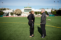 Seattle, WA - Sunday, May 21, 2017: Seattle Reign FC head coach Laura Harvey and Orlando Pride head coach Tom Sermanni during a regular season National Women's Soccer League (NWSL) match between the Seattle Reign FC and the Orlando Pride at Memorial Stadium.