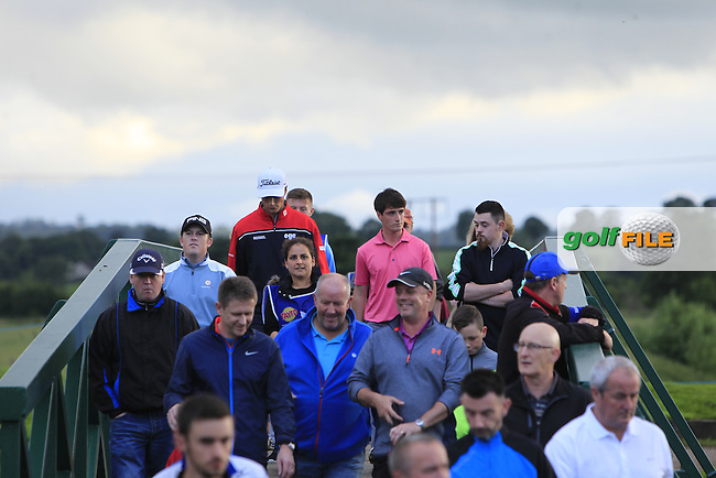 Dermot McElroy (Ballymena), in his first Professional event and surrounded by supporters walks to the 15th tee during Round 1 of the Tayto Northern Ireland Open in partnership with Ulster Bank at Galgorm Castle Golf Club, Ballymena Co. Antrim on Thursday 28th July 2016.<br /> Picture:  Golffile | Thos Caffrey<br /> <br /> All photos usage must carry mandatory copyright credit   (&copy; Golffile | Thos Caffrey)