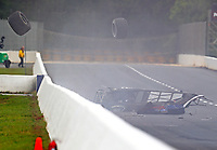 May 5, 2017; Commerce, GA, USA; A rear tire flies over the wall as NHRA super comp driver Jimmy Stahl flips over and crashes during qualifying for the Southern Nationals at Atlanta Dragway. Stahl was alert and transported to a local hospital for observation. Mandatory Credit: Mark J. Rebilas-USA TODAY Sports