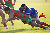 Lolohea Loco tackles Akariva Niubalavu. Counties Manukau Premier Club Rugby game between Waiuku and Ardmore Marist, played at Waiuku on Saturday June 4th 2016. Ardmore Marist won 46 - 3 after leading 39 - 3 at Halftime. Photo by Richard Spranger.