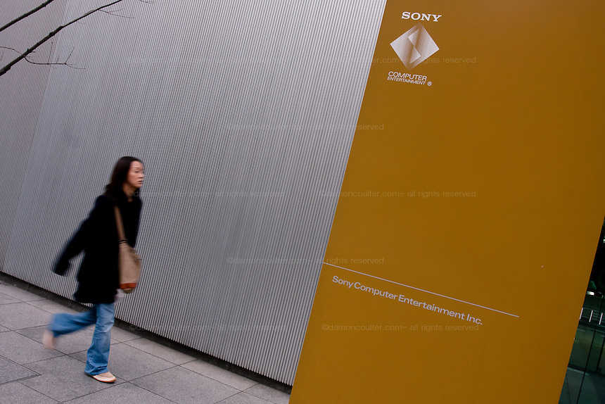 A woman approaches the entrance to Sony Computer Entertainment headquarters, Aoyama Itchome, Tokyo, Japan January 21st 2010