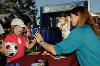 Danielle Fotopoulos of the 1999 FIFA Women's World Cup winning team, high fives a young fan before the game. Sky Blue FC defeated the Boston Breakers 2-1 during a WPS regular season match at Harvard Stadium in Boston, MA, on July 12, 2009.