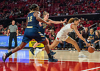 Faith Blethen #23 of and Olivia Gumbs #12 of George Washington defend against Shakira Austin #1 of Maryland