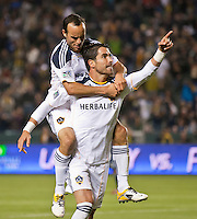 CARSON, CA – May 14, 2011: LA Galaxy forward Juan Pablo Angel (9) and Landon Donovan (10) celebrate Angel's goal during the match between LA Galaxy and Sporting Kansas City at the Home Depot Center in Carson, California. Final score LA Galaxy 4, Sporting Kansas City 1.