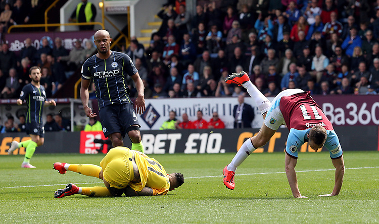 Manchester City's Ederson gathers sending Burnley's Chris Wood crashing to the ground<br /> <br /> Photographer Rich Linley/CameraSport<br /> <br /> The Premier League - Burnley v Manchester City - Sunday 28th April 2019 - Turf Moor - Burnley<br /> <br /> World Copyright © 2019 CameraSport. All rights reserved. 43 Linden Ave. Countesthorpe. Leicester. England. LE8 5PG - Tel: +44 (0) 116 277 4147 - admin@camerasport.com - www.camerasport.com