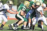 Manhattan Beach, CA 10/27/11 - Jake Shampine-Meistrell (Mira Costa #7) and Mark Pilato (Peninsula #71) in action during the Peninsula vs Mira Costa Junior Varsity football game.