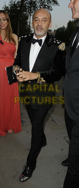 Christian Louboutin.The NSPCC Pop Art Ball, Banqqueting House, Whitehall, London, England..May 24th, 2012.full length black tuxedo.CAP/CAN.©Can Nguyen/Capital Pictures.