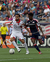 DC United midfielder Dwayne De Rosario (7) dribbles as New England Revolution midfielder Clyde Simms (19) defends. In a Major League Soccer (MLS) match, DC United defeated the New England Revolution, 2-1, at Gillette Stadium on April 14, 2012.