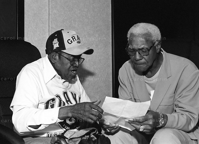 Buck O'Neil from the Negro League sitting with another player from the Gray's team