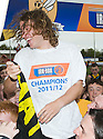 Alloa's Steven May is held aloft by the fans after lifting the 3rd division trophy.