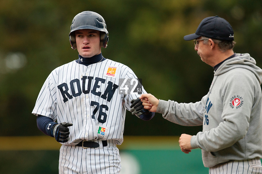 23 October 2010: Joris Bert of Rouen celebrates with Francois Colombier during Savigny 8-7 win (in 12 innings) over Rouen, during game 3 of the French championship finals, in Rouen, France.