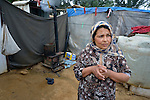Fadia, who escaped fighting in Aleppo, Syria, stands in front of her family's shelter in the Aamer al Sanad refugee settlement in Kab Elias, a town in Lebanon's Bekaa Valley which has filled with Syrian refugees. Two of her ten children were killed in Syria's civil war. <br /> <br /> Lebanon hosts some 1.5 million refugees from Syria, yet allows no large camps to be established. So refugees have moved into poor neighborhoods or established small informal settlements in border areas. International Orthodox Christian Charities, a member of the ACT Alliance, provides support for refugees in Kab Elias, including a community clinic.