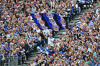 A general view of a Bath Rugby supporter in the crowd waving a giant flag. Aviva Premiership match, between Bath Rugby and Leicester Tigers on September 20, 2014 at the Recreation Ground in Bath, England. Photo by: Patrick Khachfe / Onside Images