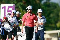 Louis Oosthuizen (RSA) and Anthony Kim (USA) walk off the 15th tee during Saturday's storm delayed conclusion of Round 2 of the Iskandar Johor Open 2011 at the Horizon Hills Golf Resort Johor, Malaysia, 19th November 2011 (Photo Eoin Clarke/www.golffile.ie)
