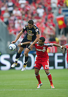 Philadelphia Union midfielder/forward Kyle Nakazawa #13 and Toronto FC forward Maicon Santos #29 in action during an MLS game between the Philadelphia Union and the Toronto FC at BMO Field in Toronto on May 28, 2011..