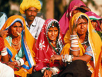 men and women in colorful traditional dress, Rajasthan, India. Sari. Turban. crowd scene, clothing, jewelry, accessories. Rajasthan India Asia.