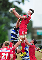 Lewis Rawlins of the Scarlets wins the ball at a lineout. Pre-season friendly match, between the Scarlets and Bath Rugby on August 20, 2016 at Eirias Park in Colwyn Bay, Wales. Photo by: Patrick Khachfe / Onside Images