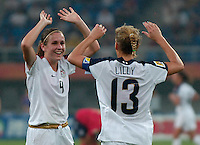 USA forward Heather O'Reilly (9) congratulates forward Kristine Lilly (13) on her goal in the 60th minute. The United States (USA) defeated England (ENG) 3-0 during a quarter-final match of the FIFA Women's World Cup China 2007 at Tianjin Olympics Center Stadium in Tianjin, China, on September 22, 2007.