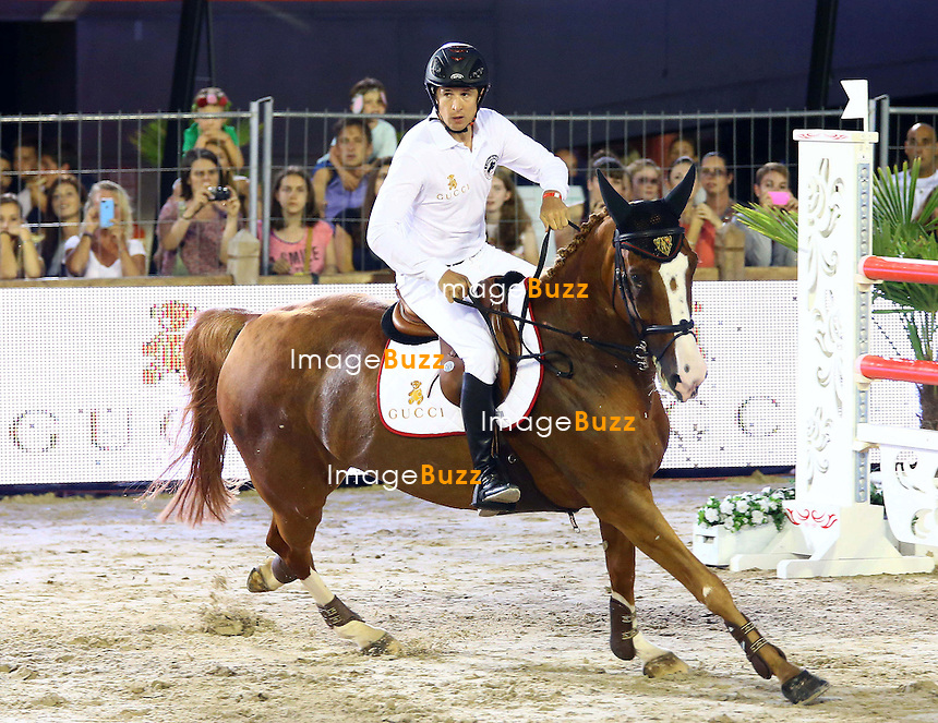 Guillaume Canet of the Gucci kids team rides Ramsexy Z as he attends the Longines Pro-Am Cup Monaco 2014 during the International Monte-Carlo Jumping at Port Hercule on June 27, 2014 in Monaco, Monaco