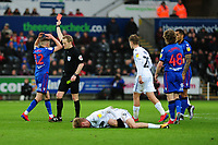 Craig Noone of Bolton Wanderers is shown a red card for a foul on Oli McBurnie of Swansea City during the Sky Bet Championship match between Swansea City and Bolton Wanderers at the Liberty Stadium in Swansea, Wales, UK.  Saturday 02 March, 2019