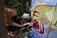 Artist Katherine Viani paints an electrical box on Mission Boulevard in Mission Beach, San Diego, California on Friday, June 6, 2008.  Viani, a certified SCUBA diver said that it was the first box that she had painted and hopes that it will brighten up the neighborhood.