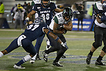 Hawaii running back Fred Holly III (21) is hit by Nevada's Daylon Johnson (37) in the first half of an NCAA college football game in Reno, Nev. Saturday, Sept. 28, 2019. (AP Photo/Tom R. Smedes)
