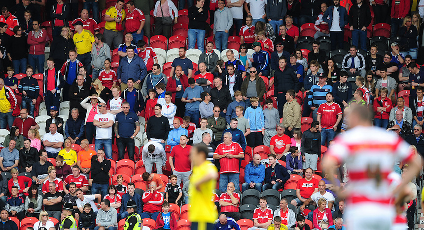 Middlesbrough fans during the first half<br /> <br /> Photographer Chris Vaughan/CameraSport<br /> <br /> Football - Pre-Season Friendly - Doncaster Rovers v Middlesbrough - Saturday 25th July 2015 - Keepmoat Stadium, Doncaster<br /> <br /> &copy; CameraSport - 43 Linden Ave. Countesthorpe. Leicester. England. LE8 5PG - Tel: +44 (0) 116 277 4147 - admin@camerasport.com - www.camerasport.com