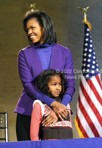 Philadelphia, PA - January 17, 2009 -- United States President-elect Barack Obama's wife Michelle embraces their daughter, Sasha, 7, as they arrives on stage for a rally to kickoff his Whistle Stop Train Tour in Philadelphia on Saturday, January 17, 2009. The ceremonial trip will carry President-elect Obama, Vice President-elect Biden and their families to Washington for their inaugurations with additional events in Philadelphia, Wilmington and Baltimore. Obama will be sworn in as the 44th President of the United States on January 20, 2009. .Credit: Kevin Dietsch - Pool via CNP