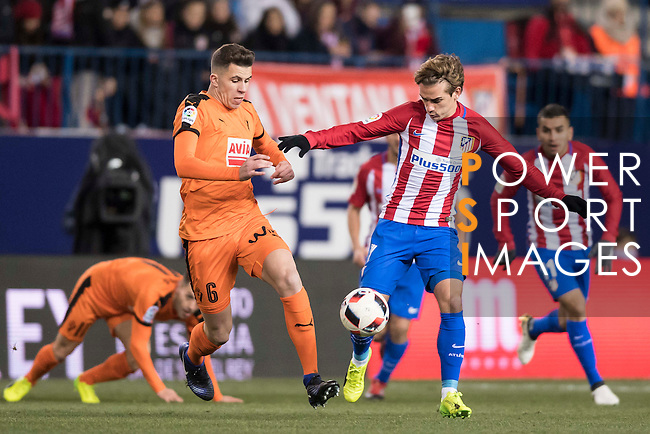 Antoine Griezmann (r) of Atletico de Madrid fights for the ball with Cristian Rivera Hernandez of SD Eibar during their Copa del Rey 2016-17 Quarter-final match between Atletico de Madrid and SD Eibar at the Vicente Calderón Stadium on 19 January 2017 in Madrid, Spain. Photo by Diego Gonzalez Souto / Power Sport Images